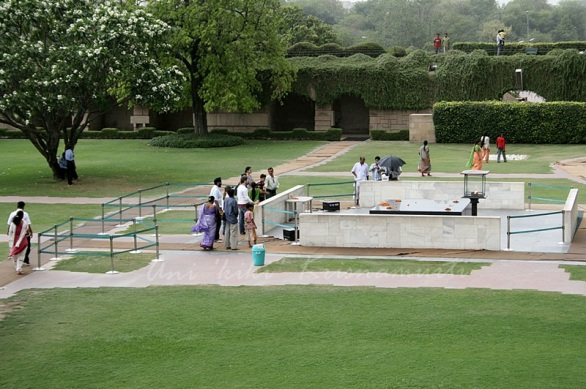 The simple square platform of black marble marks the place where Mahatama Gandhi was cremated