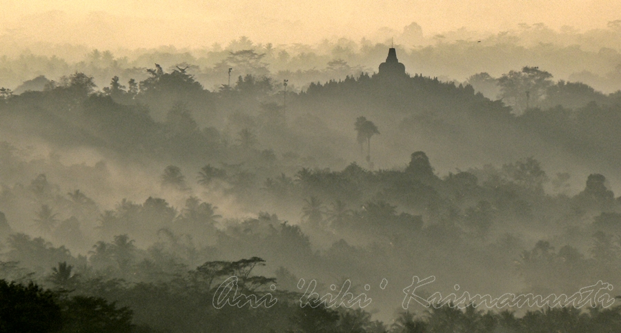 sunrise over borobudur temple, viewed from setumbu hill, magelang, central java